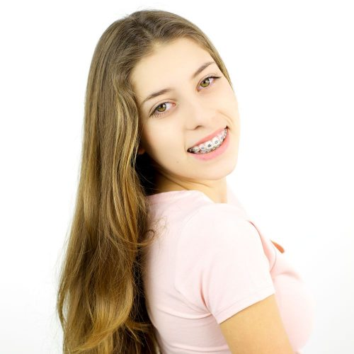 Young female teenager model smiling